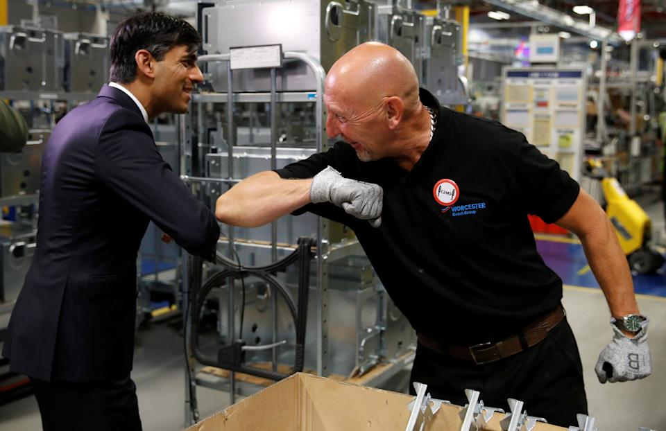 Chancellor of the exchequer Rishi Sunak greets an employee during a visit to the Worcester Bosch factory in Worcester, Britain. Photo: Phil Noble/Reuters