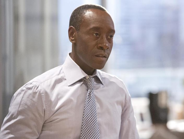 """This publicity image released by Showtime shows Don Cheadle as Marty Kaan in """"House of Lies."""" Cheadle was nominated for an Emmy Award for best actor in a comedy series on, Thursday July 18, 2013. The Academy of Television Arts & Sciences' Emmy ceremony will be hosted by Neil Patrick Harris. It will air Sept. 22 on CBS. (AP Photo/Showtime, Michael Desmond)"""
