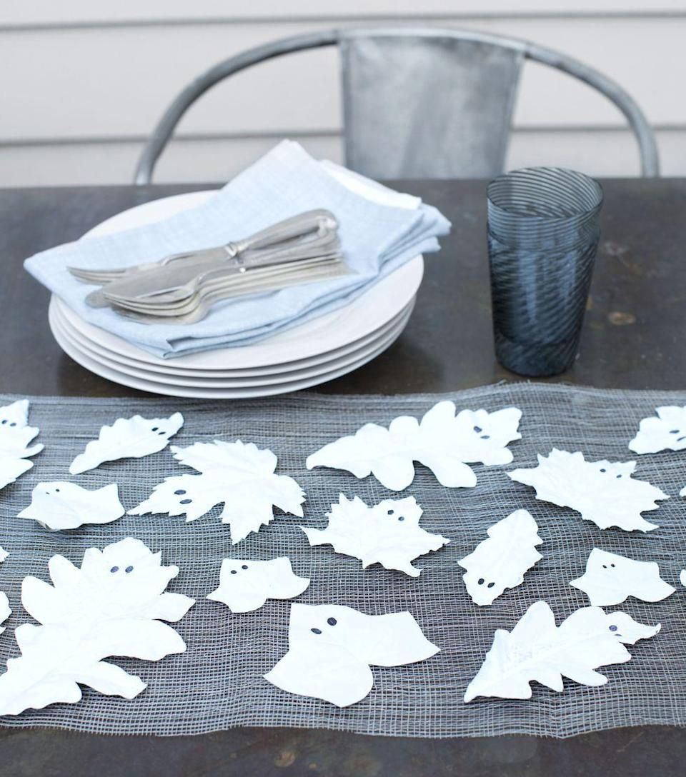 "<p>Send the kids out to forage for fallen leaves, and then head indoors to make these un-boo-lievably adorable ghosts. Paint the leaves with white paint. Once dry, draw on black eyes with black permanent marker. String them together for a spooky garland, scatter them along the table, or use them as place cards.</p><p><a class=""link rapid-noclick-resp"" href=""https://www.amazon.com/Handy-Student-Acrylic-Paint-Titanium/dp/B007TIDLK2/?tag=syn-yahoo-20&ascsubtag=%5Bartid%7C10050.g.4950%5Bsrc%7Cyahoo-us"" rel=""nofollow noopener"" target=""_blank"" data-ylk=""slk:SHOP WHITE PAINT"">SHOP WHITE PAINT</a></p>"