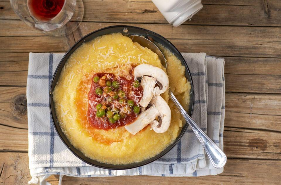 """<p>You can dress up this bowl of soft, hearty bowl of polenta in a myriad of ways: Add fresh or frozen veggies, for one, or even leftover roasts or saved fish from your last formal dinner. The cornmeal and milk combine into a creamy base that's ready in just 12 minutes.</p><p><em><a href=""""https://www.goodhousekeeping.com/food-recipes/a8719/microwave-polenta-ghk0108/"""" rel=""""nofollow noopener"""" target=""""_blank"""" data-ylk=""""slk:Get the recipe for Microwave Polenta »"""" class=""""link rapid-noclick-resp"""">Get the recipe for Microwave Polenta »</a></em></p>"""