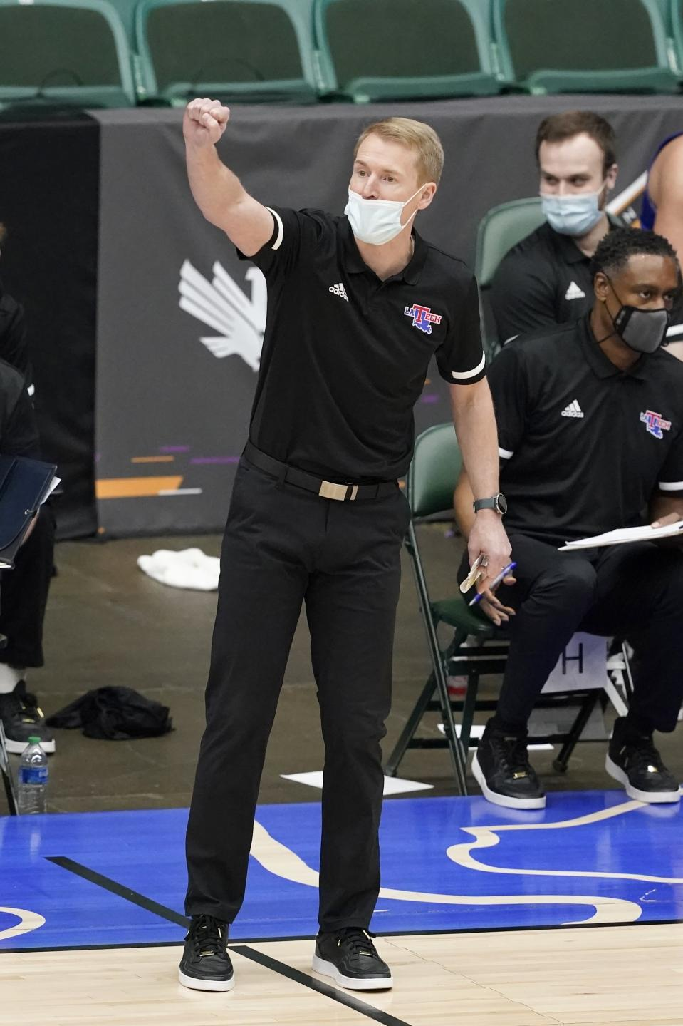 Louisiana Tech head coach Eric Konkol instructs his team in the second half of an NCAA college basketball game against Colorado State in the NIT, Sunday, March 28, 2021, in Frisco, Texas. (AP Photo/Tony Gutierrez)
