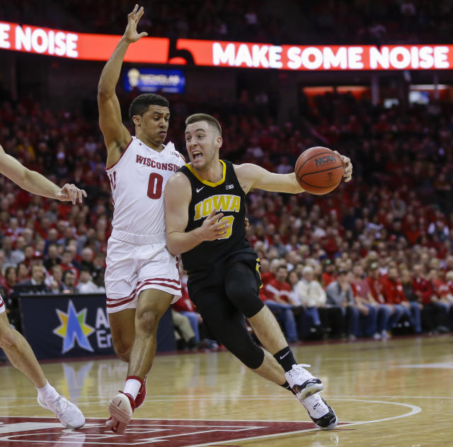 Iowa's Connor McCaffery (30) drives against Wisconsin's D'Mitrik Trice (0) during the first half of an NCAA college basketball game Thursday, March 7, 2019, in Madison, Wis. (AP Photo/Andy Manis)