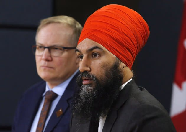 NDP leader Jagmeet Singh, right, and NDP finance critic Peter Julian speak at a press conference in the National Press Theatre in Ottawa on Feb. 13, 2018.