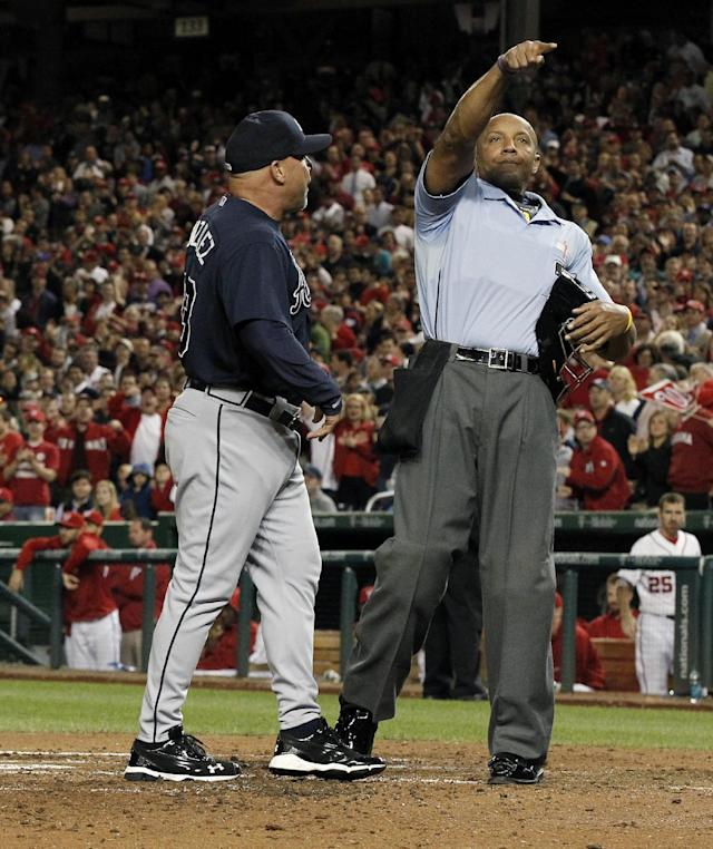 Atlanta Braves manager Fredi Gonzalez, left, is ejected by home plate umpire CB Bucknor during the fifth inning of a baseball game against the Washington Nationals at Nationals Park, Wednesday, Sept. 18, 2013, in Washington. Bucknor called a pitch a ball with the bases loaded and a full count. (AP Photo/Alex Brandon)
