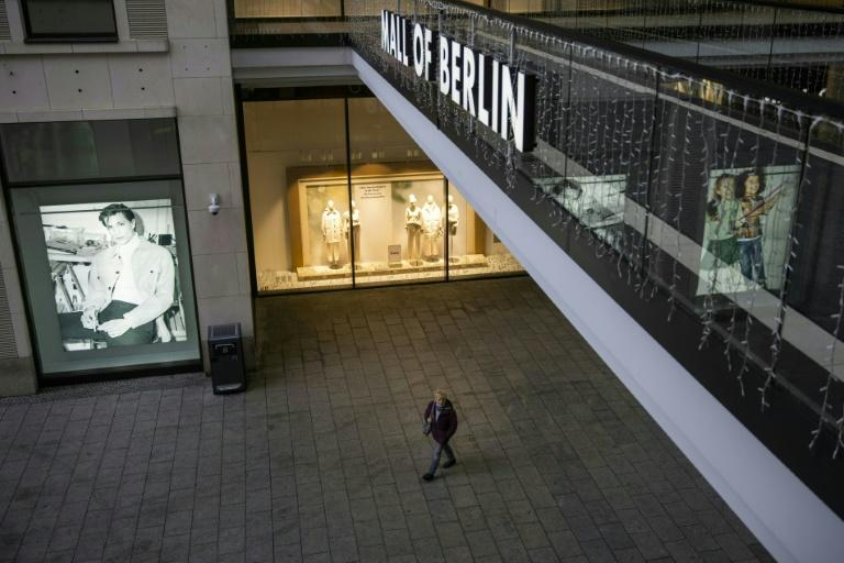 """A lone pedestrian is seen walking in """"Mall of Berlin"""", the German capital's biggest shopping mall"""