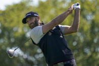 Dustin Johnson, of the United States, plays his shot from the fourth tee during the third round of the US Open Golf Championship, Saturday, Sept. 19, 2020, in Mamaroneck, N.Y. (AP Photo/John Minchillo)