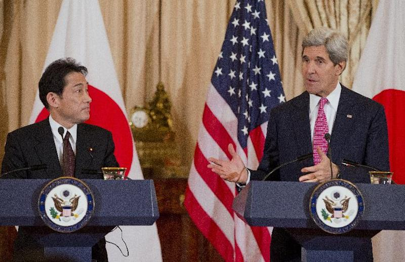 Japanese Foreign Minister Fumio Kishida listens as Secretary of State John Kerry speaks after a meeting at the State Department in Washington, Friday, Feb. 7, 2014. (AP Photo/ Evan Vucci)