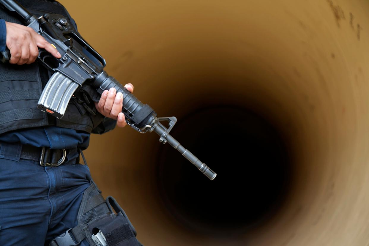 A federal police inspects a drainage pipe outside the Altiplano maximum security prison in Almoloya, west of Mexico City, Sunday, July 12, 2015. (AP Photo/Marco Ugarte)