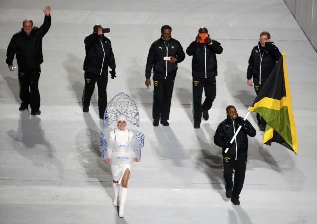 Jamaica's flag-bearer Marvin Dixon leads his country's contingent during the athletes' parade at the opening ceremony of the 2014 Sochi Winter Olympics, February 7, 2014. REUTERS/Lucy Nicholson (RUSSIA - Tags: OLYMPICS SPORT)
