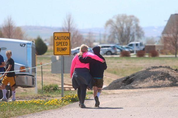 PHOTO: Two people walk together near the scene of a shooting at an eastern Idaho middle school Thursday, May 6, 2021, in Rigby, Idaho. (Natalie Behring/AP, FILE)