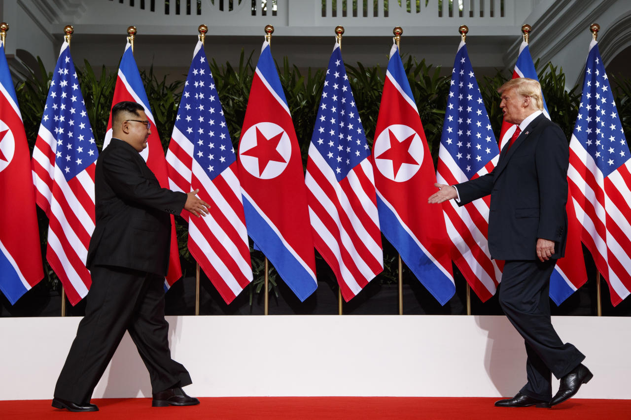 <p> In this June 12, 2018, photo, President Donald Trump meets with North Korean leader Kim Jong Un on Sentosa Island in Singapore. Trump credits his accord with North Korea's Kim Jong Un with saving tens of millions from nuclear war. Now he just has to get everyone else on board. Frustrated with lukewarm backing from congressional Republicans, criticism from Democratic opponents, and skepticism from allies and the media, President Donald Trump made an extraordinary stop on the North Lawn of the White House Friday to promote the nuclear deal that critics have decried as a vague and lacking in clear objectives. (AP Photo/Evan Vucci) </p>
