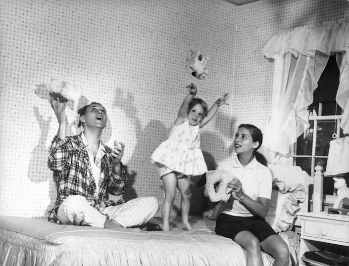 "<b>Summer 1958</b> Ruth Bader Ginsburg and Martin Ginsburg play with their three-year old daughter, Jane, in her bedroom at Martin's parents' home in Rockville Centre, N.Y <span class=""copyright"">Collection of the Supreme Court of the United States</span>"