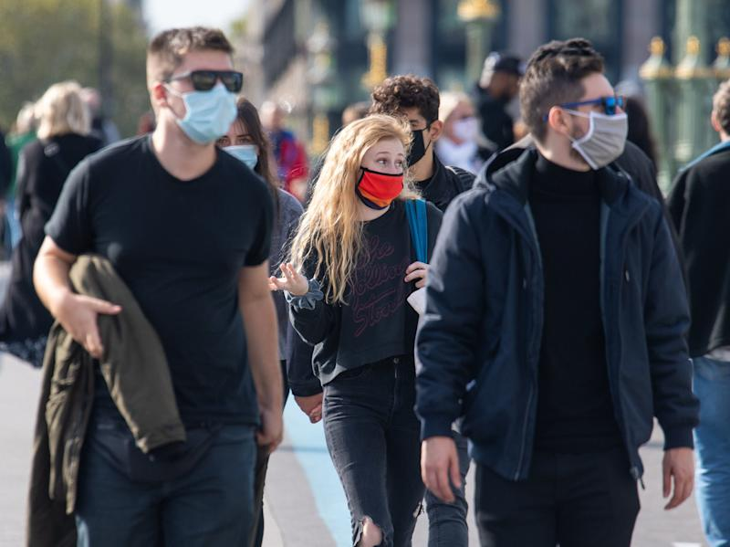 People wearing protective face masks in Westminster, London, after a range of new restrictions to combat the rise in coronavirus cases came into place in England. (Dominic Lipinski/PA)