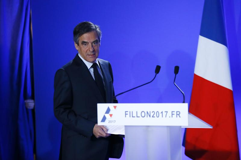 Conservative presidential candidate Francois Fillon arrives to deliver his speech at his campaign headquarters in Paris, Wednesday, March 1, 2017. Fillon's campaign for the French presidency faced new uncertainty Wednesday as he abruptly canceled a campaign stop at the country's premier farm fair and an investigation intensified into alleged fake parliamentary jobs for his family. (AP Photo/Francois Mori)