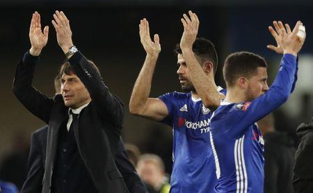 Chelsea manager Antonio Conte celebrates after the match with Eden Hazard and Diego Costa
