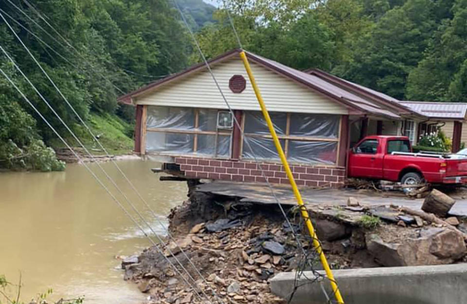 This photo provided by Bristol Virginia Professional FireFighters Association shows damage from severe weather on Monday, Aug. 30, 2021 in Hurley, Va. About 20 homes were moved from their foundations and several trailers washed away amid flooding in western Virginia from the remnants of Hurricane Ida, local officials said. (Bristol Virginia Professional FireFighters Association via AP)