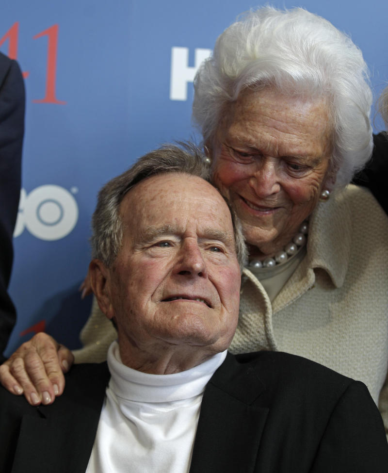 """Former President George H.W. Bush, and his wife Barbara, arrive for the premiere of HBO's new documentary on his life in Kennebunkport, Maine, Tuesday, June 12, 2012.  The premiere of """"41"""" was held Tuesday on Bush's 88th birthday on the grounds of St. Ann's Church in Kennebunkport, near the Bush family's summer home.(AP Photo/Charles Krupa)"""