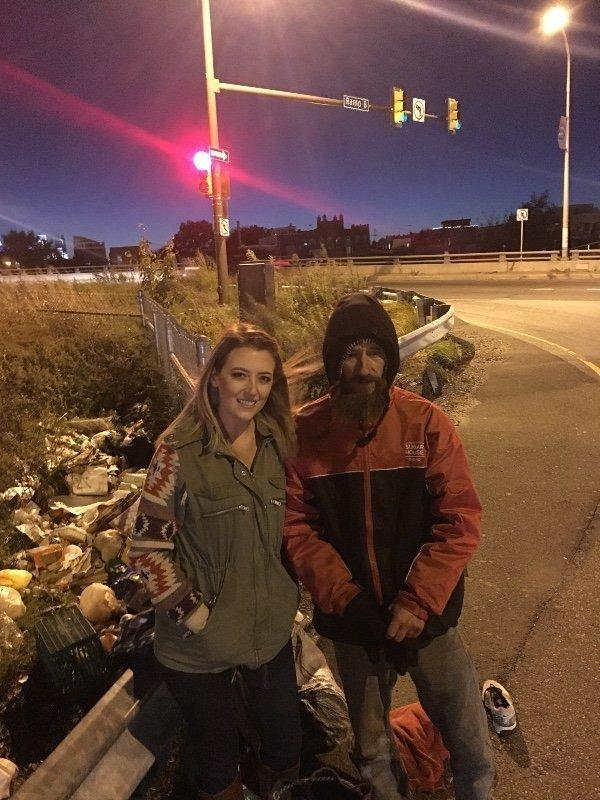 New Jersey resident Kate McClure pictured with Johnny, a homeless man who helped her when she needed it. (GoFundMe)