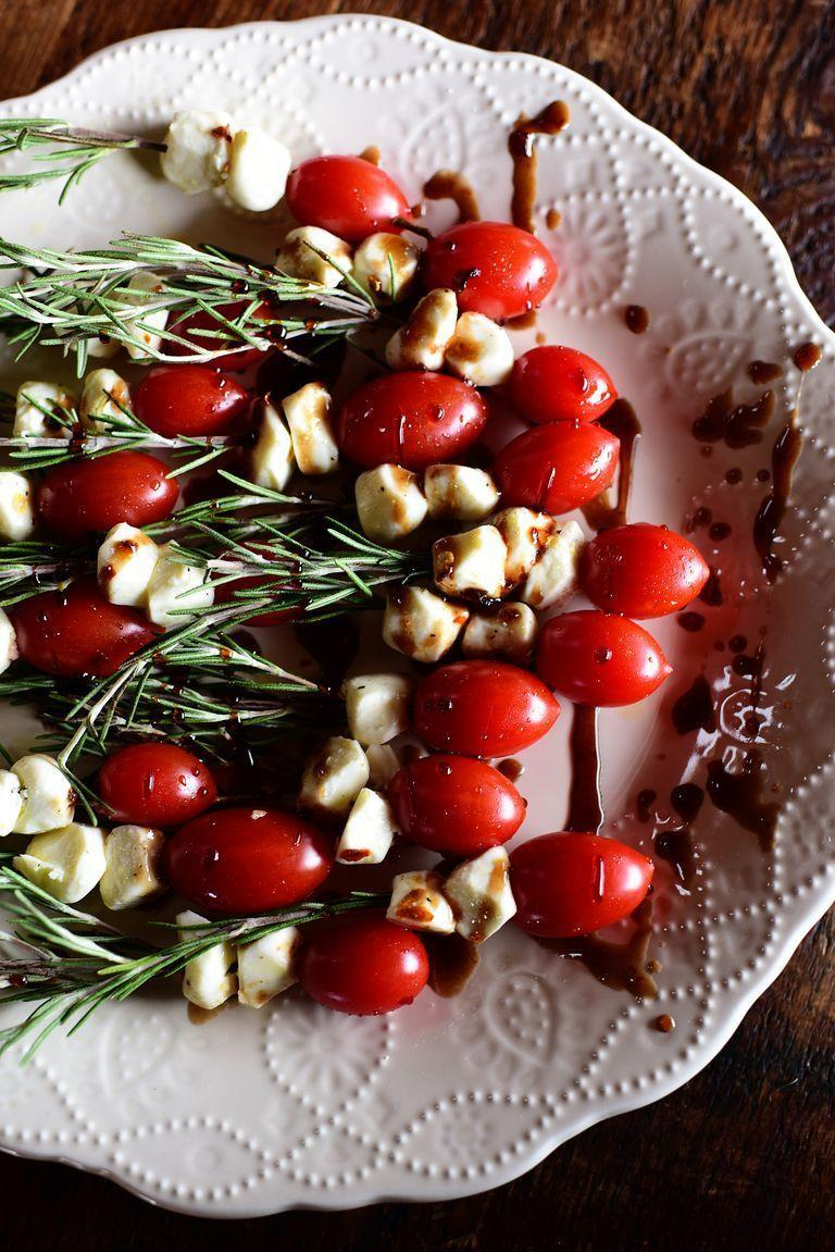 """<p>The balsamic glaze on these """"skewers"""" is made with plum preserves. It's an all-around Christmassy bite!</p><p><strong><a href=""""https://www.thepioneerwoman.com/food-cooking/recipes/a78788/rosemary-caprese-skewers/"""" rel=""""nofollow noopener"""" target=""""_blank"""" data-ylk=""""slk:Get the recipe"""" class=""""link rapid-noclick-resp"""">Get the recipe</a>.</strong></p><p><a class=""""link rapid-noclick-resp"""" href=""""https://go.redirectingat.com?id=74968X1596630&url=https%3A%2F%2Fwww.walmart.com%2Fbrowse%2Fhome%2Fcooking-utensils%2F4044_623679_133020_4496646_3272847%3Ffacet%3Dbran%253AThe%2BPioneer%2BWoman&sref=https%3A%2F%2Fwww.thepioneerwoman.com%2Ffood-cooking%2Fmeals-menus%2Fg34272733%2Fchristmas-party-appetizers%2F"""" rel=""""nofollow noopener"""" target=""""_blank"""" data-ylk=""""slk:SHOP KITCHEN TOOLS"""">SHOP KITCHEN TOOLS</a></p>"""