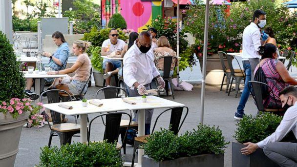 PHOTO: An outdoor dining area is seen as the city continues Phase 4 of re-opening following restrictions imposed to slow the spread of coronavirus on July 27, 2020, in New York. (Jamie McCarthy/Getty Images)