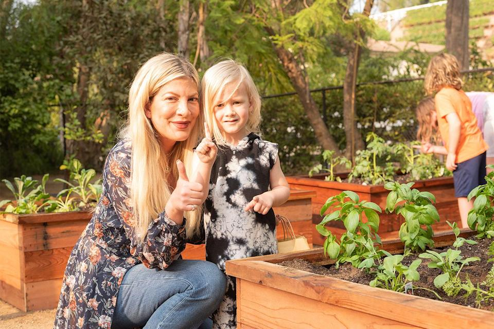 """<p>The <em>BH90210 </em>star is giving a green thumbs-up to her new herb and vegetable garden at her family home in Hidden Hills, California.</p> <p>The actress and her five kids have been gardening up a storm after <a href=""""https://www.mandausa.com/"""" rel=""""nofollow noopener"""" target=""""_blank"""" data-ylk=""""slk:plant food company Manda USA"""" class=""""link rapid-noclick-resp"""">plant food company Manda USA</a> built four raised boxes in their backyard filled with organic broccoli, celery, radishes, kale, green onions, basil and more. </p> <p>""""I'm very excited about this garden and love the idea of growing your own food and practicing sustainability with my family,"""" Spelling said of the new additions. </p>"""