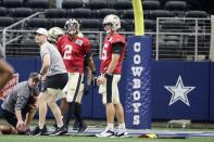 New Orleans Saints quarterbacks Jameis Winston (2) and Trevor Siemian, right, participate in the team's NFL football workout at AT&T Stadium in Arlington, Texas, Monday, Aug. 30, 2021. Displaced by Hurricane Ida, the Saints went back to work Monday about 500 miles away in the home of another NFL team. (AP Photo/Michael Ainsworth)