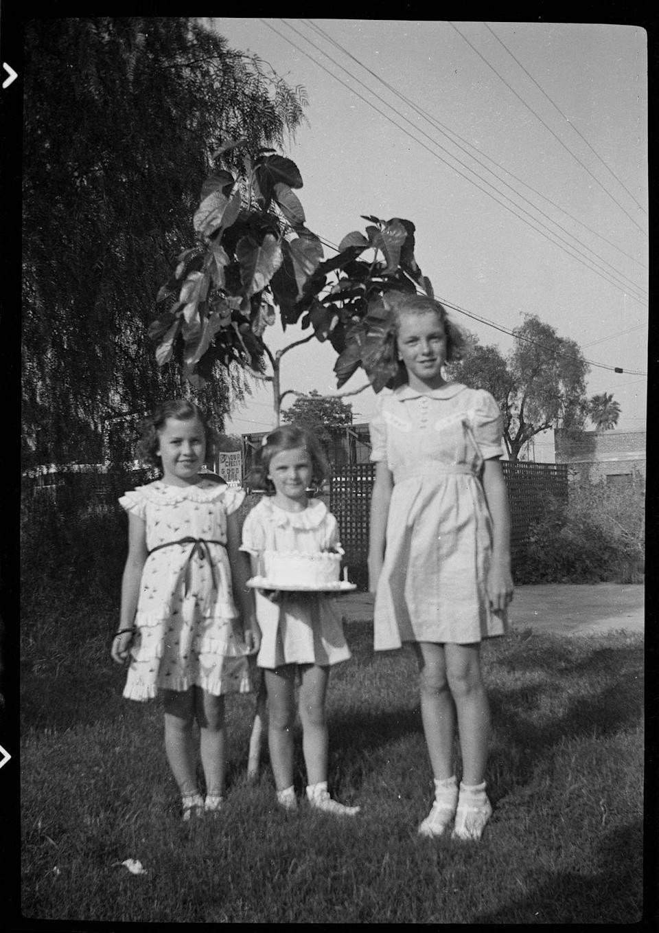 <p>Despite her tough childhood, Norma Jeane was still able to find moments of happiness, like this birthday celebration with two of her friends. <br></p>