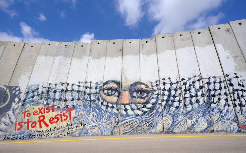 A mural on the Israeli West Bank barrier - Getty