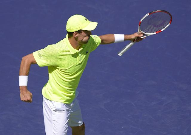 Roberto Bautista Agut, of Spain, celebrates his 4-6, 6-2, 6-4 victory over Tomas Berdych, of the Czech Republic, in a match at the BNP Paribas Open tennis tournament on Sunday, March 9, 2014, in Indian Wells, Calif. (AP Photo/Mark J. Terrill)