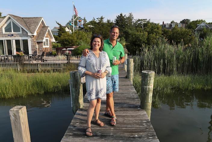 Sam and Mariah Calagione of Dogfish Head at the dock of their Lewes home.