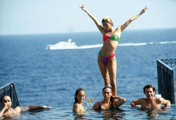 <p>The future wife of Pavlos, Crown Prince of Greece, lounging with friends at a pool in 1991. </p>