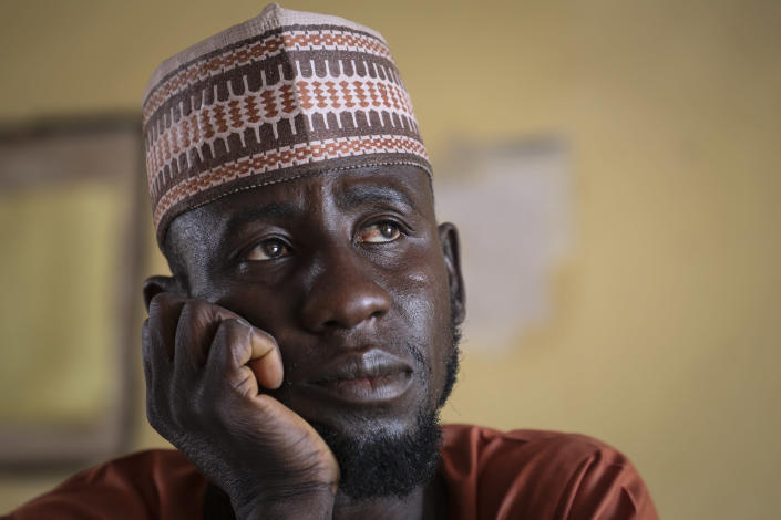 Father Kabiru Sani Jangebe, who has three daughters amongst the more than 300 girls abducted from their boarding school on Friday, waits for news at the school in Jangebe town, Zamfara state, northern Nigeria Saturday, Feb. 27, 2021. Nigerian police and the military have begun joint operations to rescue the more than 300 girls who were kidnapped from the Government Girls Junior Secondary School, according to a police spokesman. (AP Photo/Ibrahim Mansur)