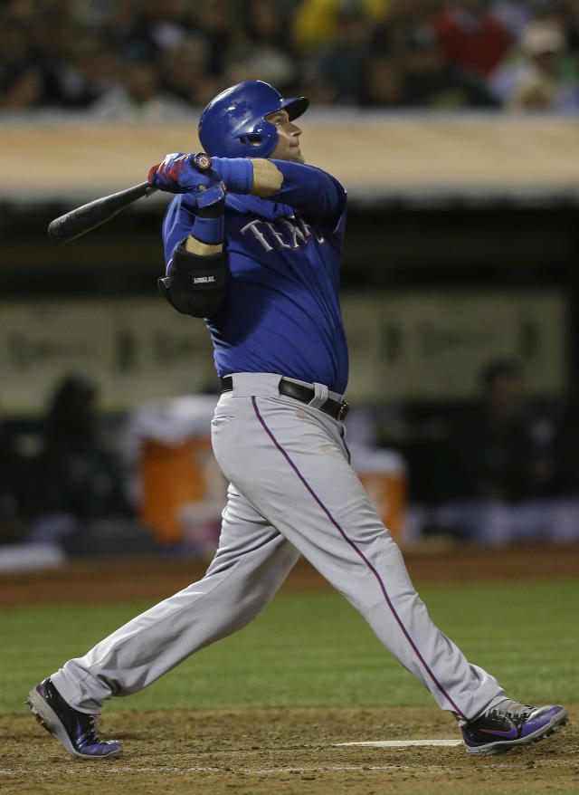Texas Rangers' A.J. Pierzynski hits an RBI single to score Ian Kinsler off of Oakland Athletics pitcher Bartolo Colon in the fifth inning of a baseball game in Oakland, Calif., Tuesday, Sept. 3, 2013. (AP Photo/Jeff Chiu)