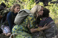 """This image released by Paramount Pictures shows Millicent Simmonds, from left, Emily Blunt and Noah Jupe in a scene from """"A Quiet Place Part II."""" (Jonny Cournoyer/Paramount Pictures via AP)"""