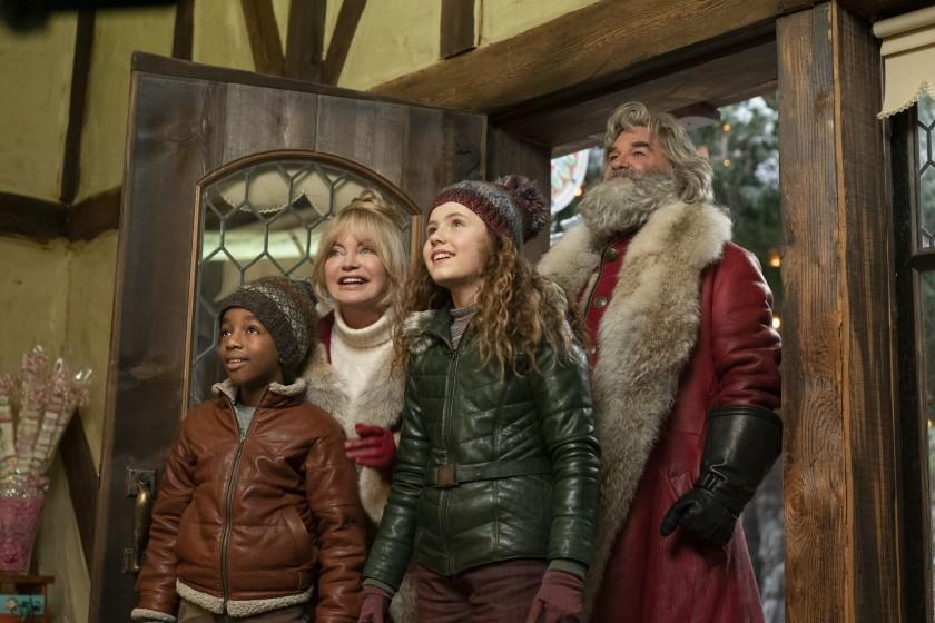 EXCLUSIVE: THE CHRISTMAS CHRONICLES: PART TWO (L to R) JAHZIR BRUNO as JACK, GOLDIE HAWN as MRS. CLAUS, DARBY CAMP as KATE, KURT RUSSELL as SANTA CLAUS in THE CHRISTMAS CHRONICLES: PART TWO. Cr. JOSEPH LEDERER/NETFLIX © 2020