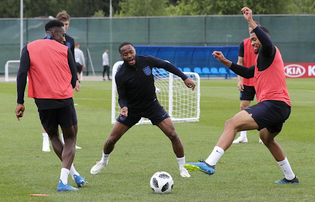 Raheem Sterling joins in a game of keep-ball as the England squad trained in a buoyant atmosphere. (Getty)