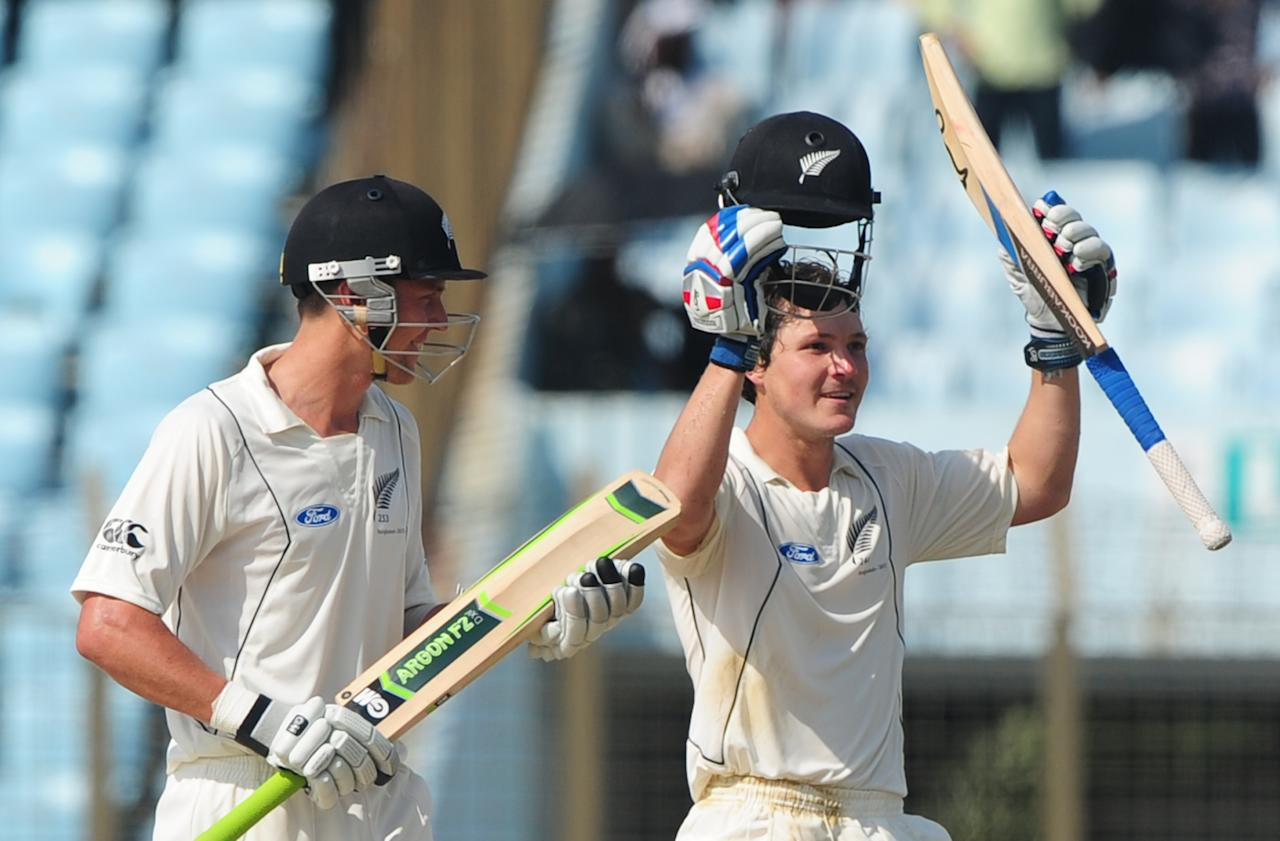 New Zealand batsman B J Walting (R) reacts after scoring a century (100 runs) as his teammate Trent Boult (L) applauds during the second day of the first cricket Test match between Bangladesh and New Zealand at The Zahur Ahmed Chowdhury Stadium in Chittagong on October 10, 2013. AFP PHOTO/Munir uz ZAMAN        (Photo credit should read MUNIR UZ ZAMAN/AFP/Getty Images)