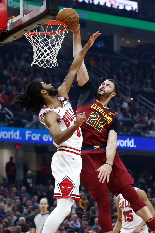 Cleveland Cavaliers' Larry Nance Jr. (22) dunks against Chicago Bulls' Coby White (0) in the first half of an NBA basketball game, Saturday, Jan. 25, 2020, in Cleveland. (AP Photo/Ron Schwane)