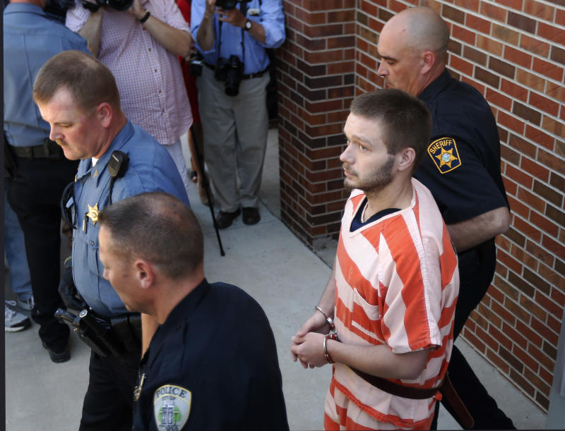 Kyle Flack is led from the detention center to the Franklin County Courthouse in Ottawa, Kan., Monday, May 13, 2013. Flack is charged with killing four people on an eastern Kansas farm  (AP Photo/Orlin Wagner)