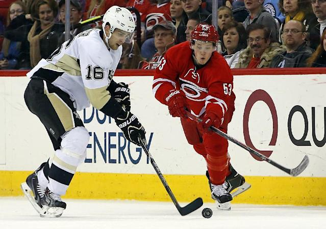 Carolina Hurricanes' Jeff Skinner (53) eyes the puck controlled by Pittsburgh Penguins' Brandon Sutter (16) during the second period of an NHL hockey game, Friday, Dec. 27, 2013, in Raleigh, N.C. (AP Photo/Karl B DeBlaker)