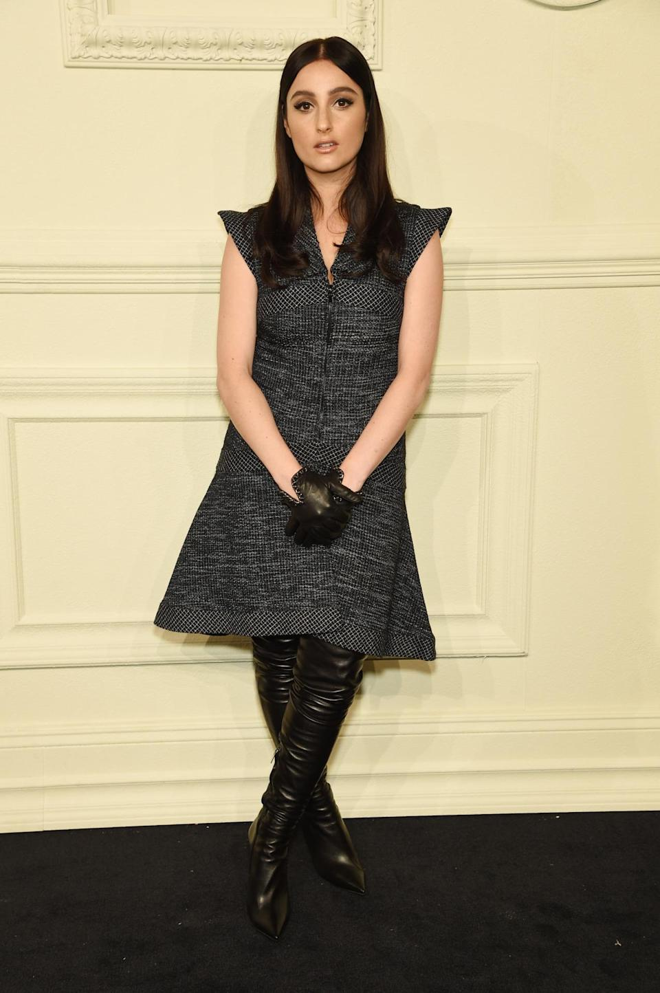 """<p>The """"Beggin for Thread"""" singer looks runway ready in a Chanel dress with shoulder accent and thigh-high leather boots.</p>"""