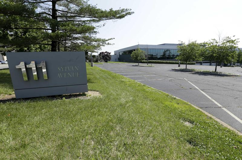 In this photograph taken Friday, June 21, 2013, in Englewood Cliffs, N.J., an empty parking lot is seen near a building on Sylvan Avenue. The electronics giant LG is planning to build a gleaming new headquarters here. One of the biggest opponents is New York's Metropolitan Museum of Art, which contends the building will ruin the view of the Palisades, a line of steep cliffs along the Hudson River, that is visible from the Cloisters. The museum is joined by numerous environmental groups and local citizens who say the building will be an eyesore on one of the country's most beautiful spaces. (AP Photo/Julio Cortez)