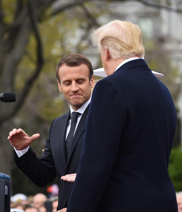 <p>French President Emmanuel Macron shakes hands with US President Donald Trump after speaking at a state welcome at the White House in Washington on April 24, 2018. (Photo: Jim Watson/AFP/Getty Images) </p>