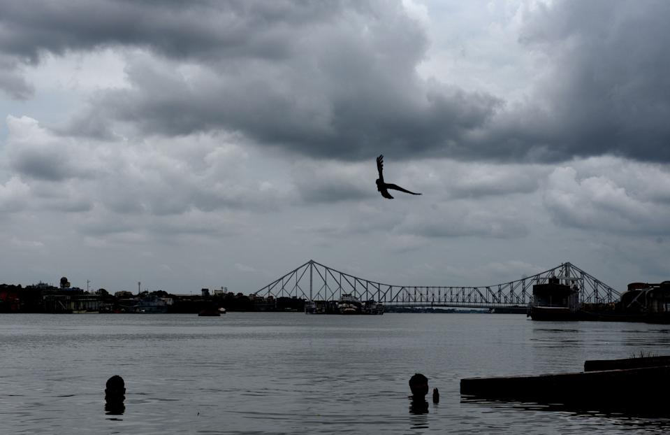 Dark clouds hover over Howrah Bridge (Rabindra Setu) on May 19, 2020 in Kolkata. (Photo by Samir Jana/Hindustan Times via Getty Images)