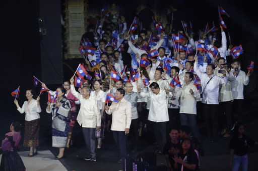 Laos' team wave flags during the opening ceremony of the 30th South East Asian Games at the Philippine Arena, Bulacan province, northern Philippines on Saturday, Nov. 30, 2019. (AP Photo/Aaron Favila)