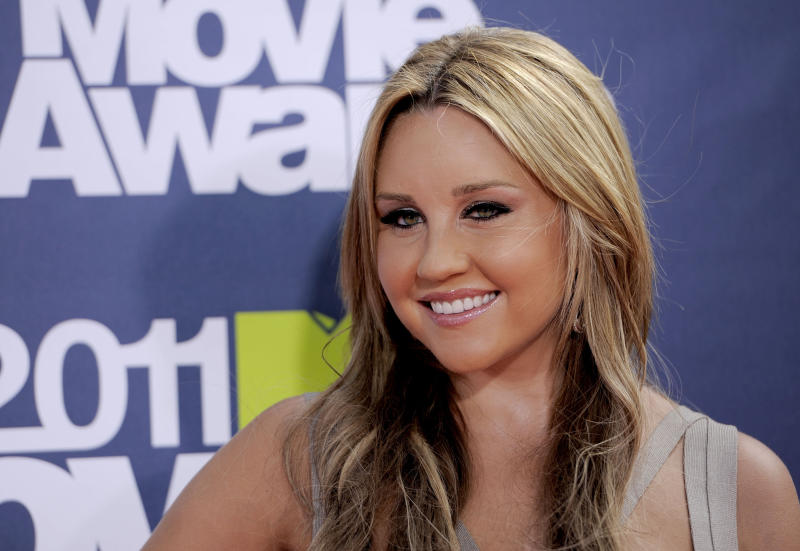 FILE - In this June 5, 2011 file photo, Amanda Bynes arrives at the MTV Movie Awards, in Los Angeles. Bynes' attorney entered a not guilty plea to two counts of driving on a suspended license on Monday, Oct. 15, 2012. (AP Photo/Chris Pizzello, File)