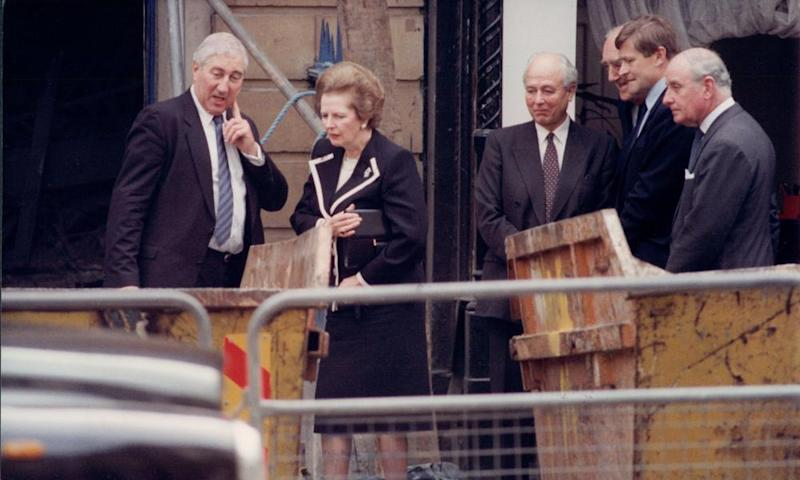 Margaret Thatcher views of the aftermath of the IRA bombing of the Carlton Club, London, in 1990.