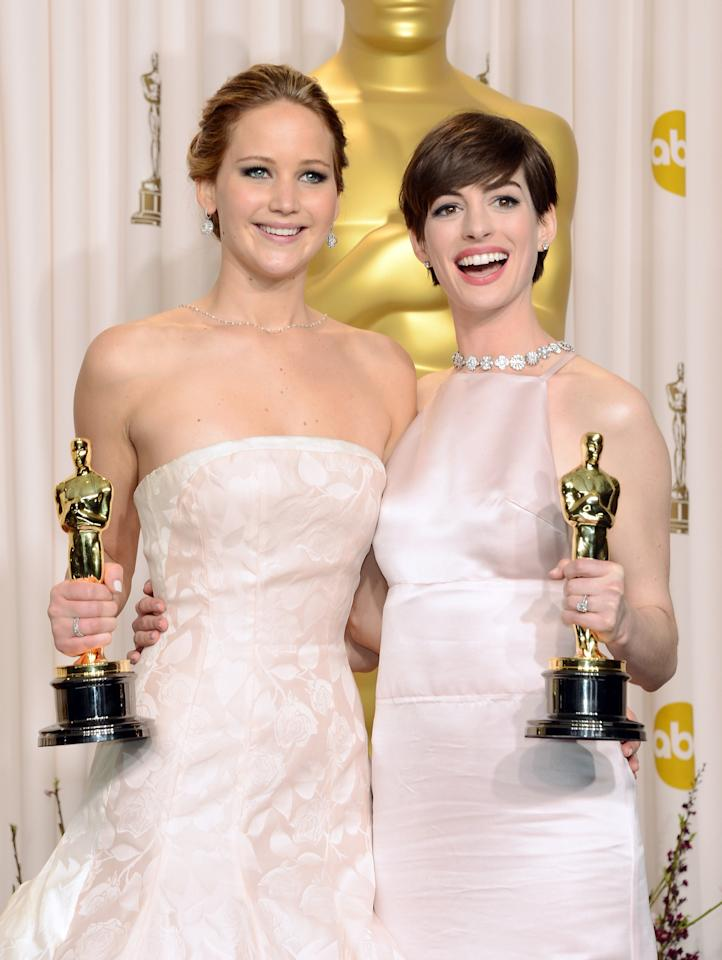 "Jennifer Lawrence (L), winner of the Best Actress award for ""Silver Linings Playbook,"" and Anne Hathaway, winner of the Best Supporting Actress award for ""Les Miserables,"" pose in the press room during the Oscars held at Loews Hollywood Hotel on February 24, 2013 in Hollywood, California.  (Photo by Jason Merritt/Getty Images)"