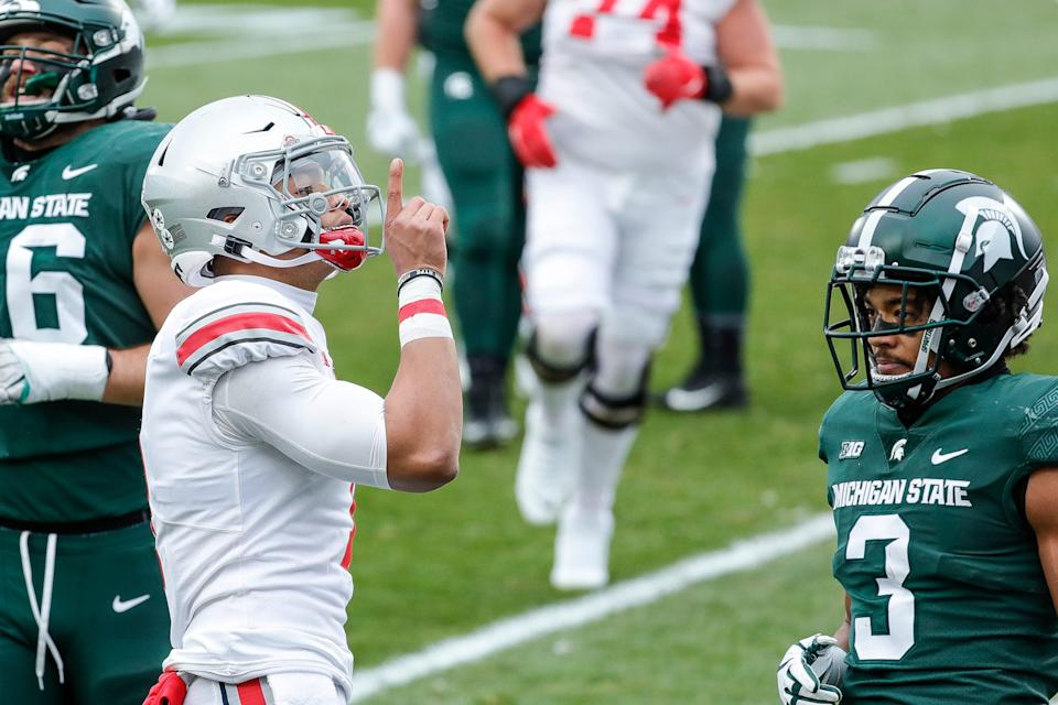 Ohio State quarterback Justin Fields celebrates a touchdown against Michigan State during the first half at Spartan Stadium in East Lansing on Saturday, Dec. 5, 2020.