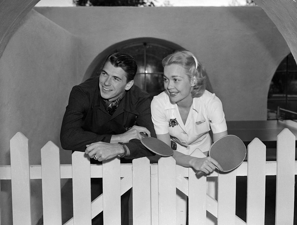 <p>Ronald Reagan and his first wife, Jane Wyman, hold ping pong paddles after finishing up a competitive game on their honeymoon. </p>